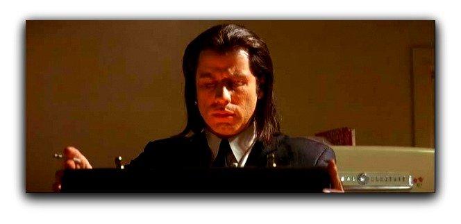 John Travolta looking in a glowing briefcase